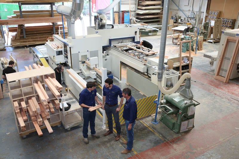 Gowercroft new timber window workshop photo taken from above with management in front of a window making machine
