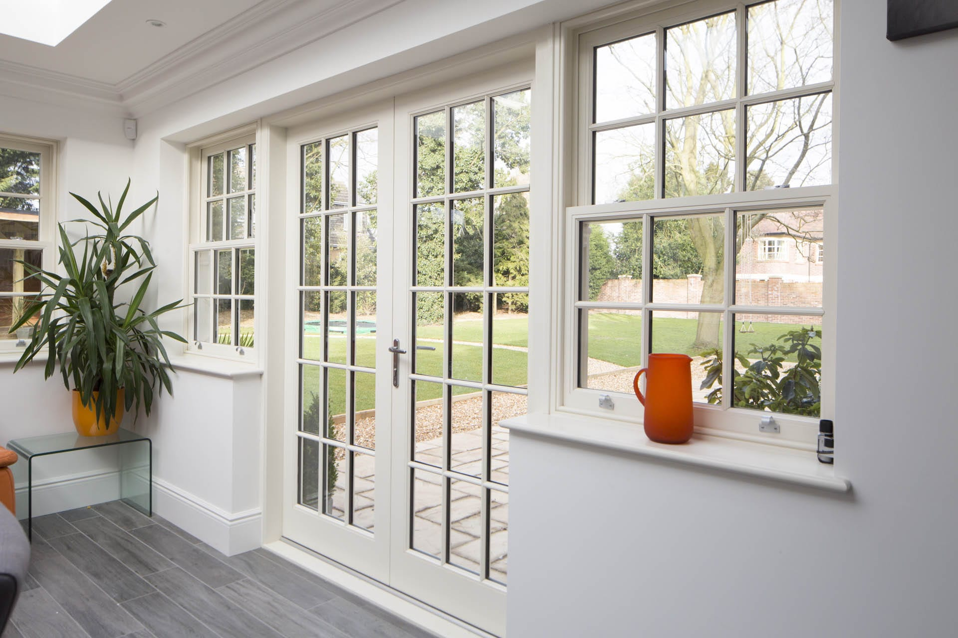 Classic range of wooden windows and doors installed in a house