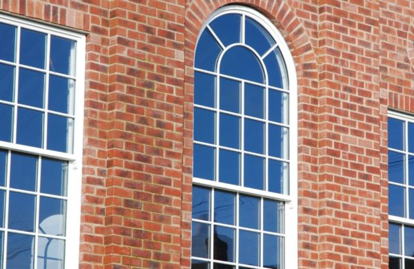 an arched spiral window made from sustainable wood by Gowercroft