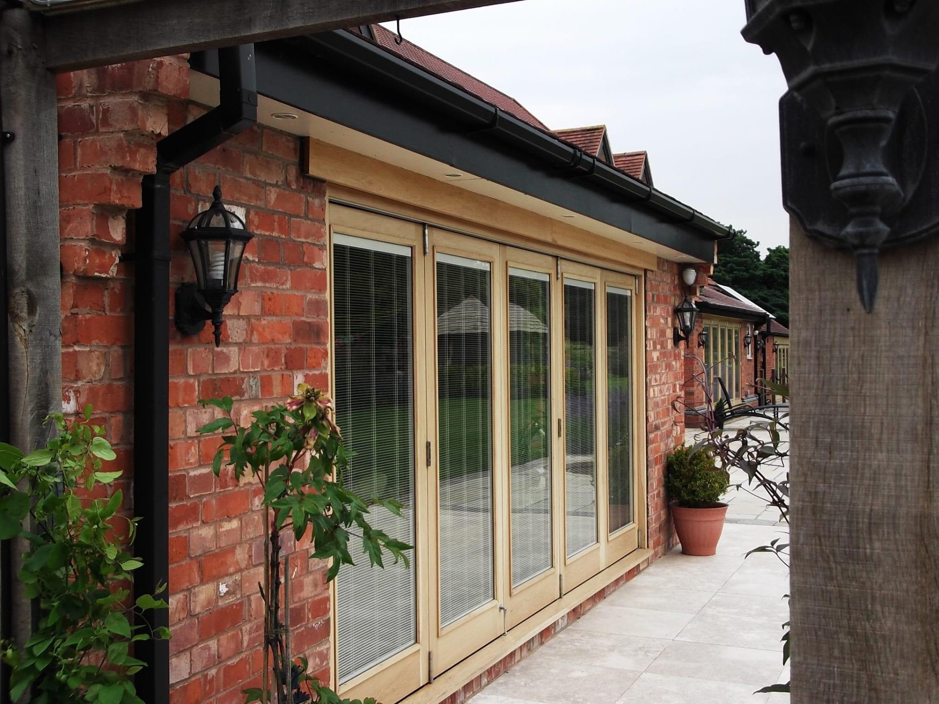 Wooden lift and slide doors looking over a nice patio