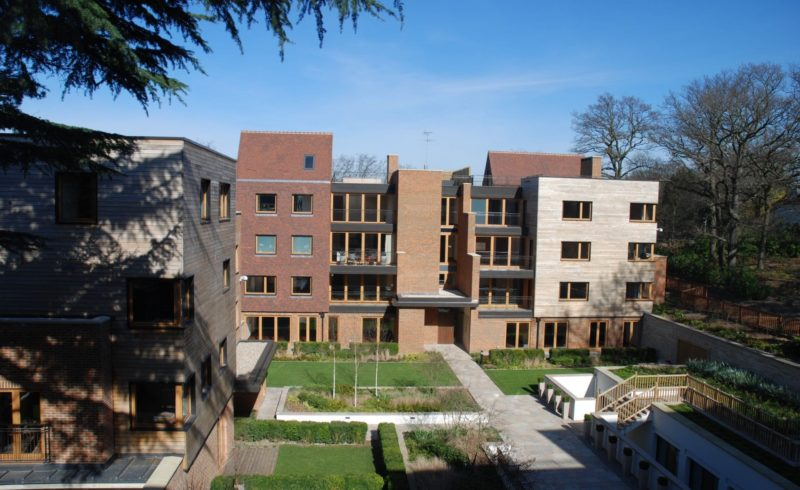 Tilt and turn windows made from wood and fitted to a residential apartment block