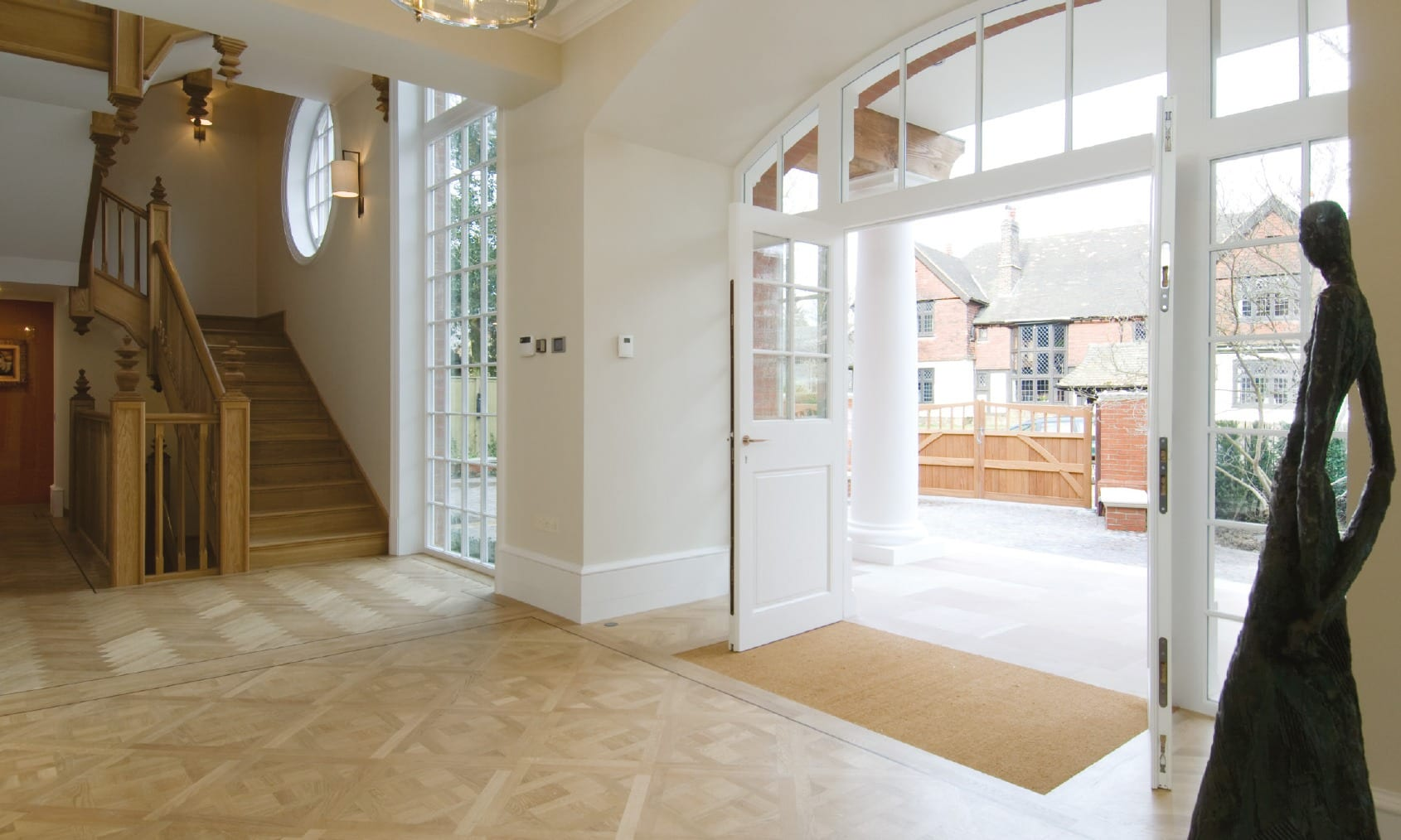 beautiful grange road entrance showing stunning timber doors and staircase
