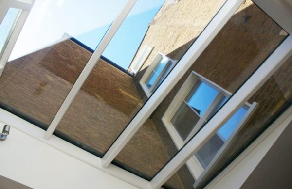 Unusual view of a wooden roof lantern showing wooden sliding sash windows in the floors above