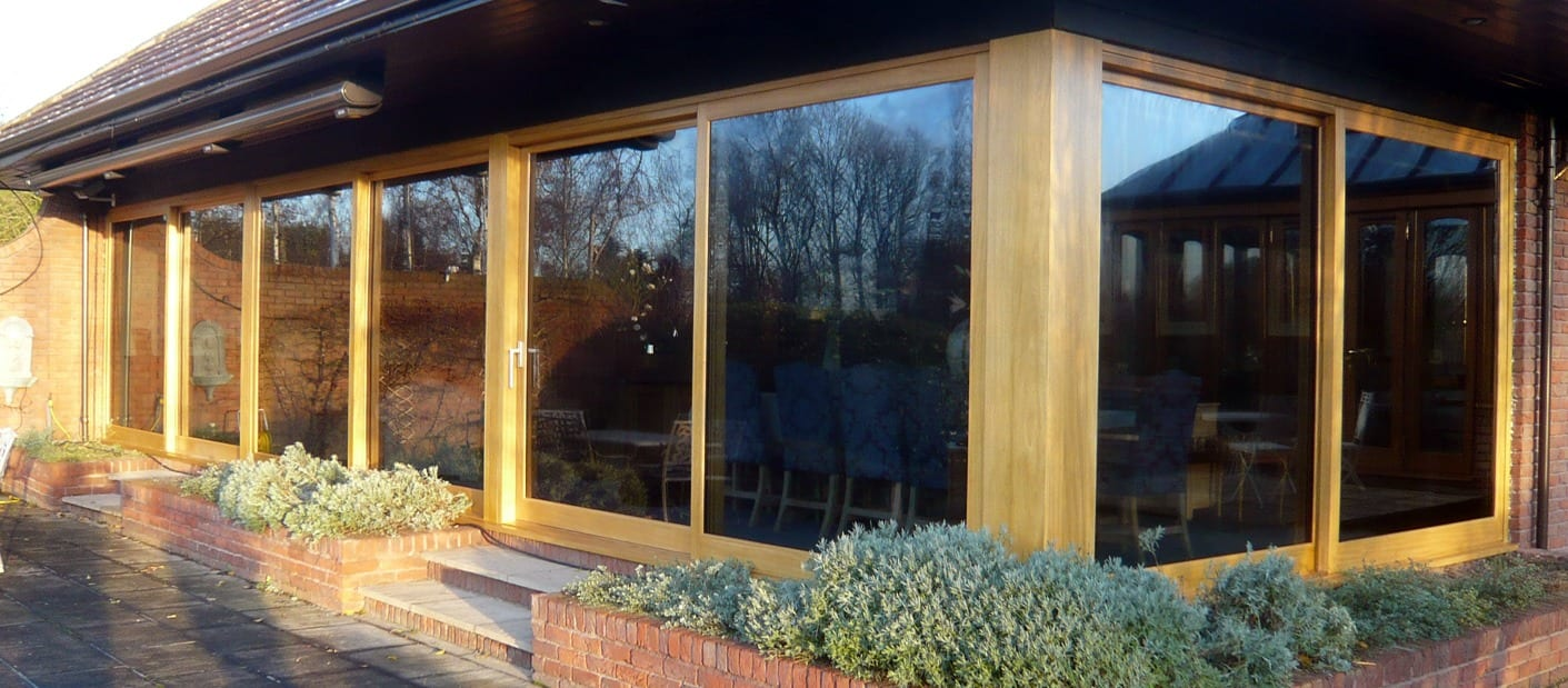 Lift and slide wooden patio doors fitted to a house