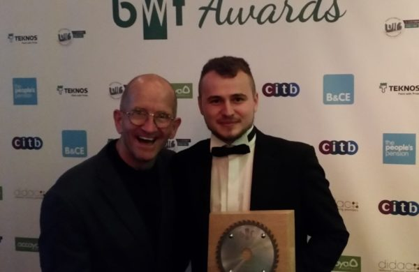 Greg receives his award from the BWF