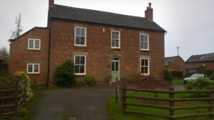 The house in Kirk Langley after restoration with hardwood windows by Gowercroft