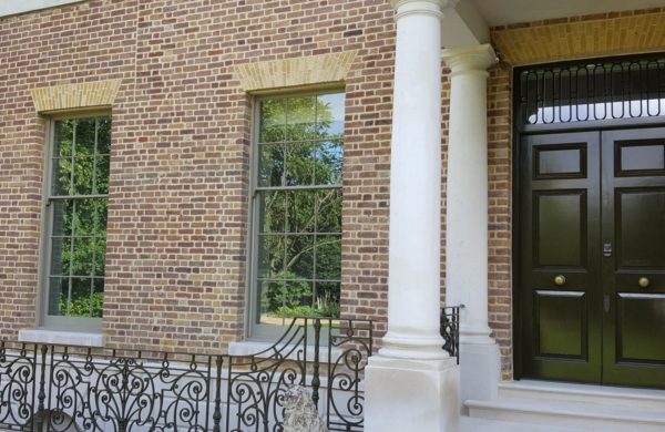 double glazing on a rich looking house with timber windows and impressive double wooden doors in london