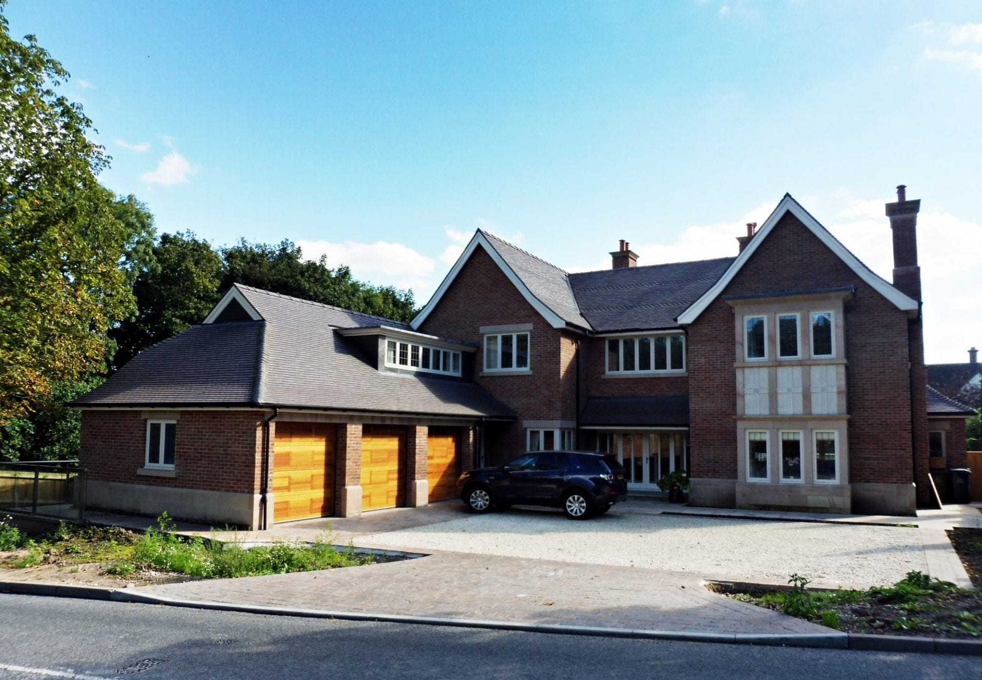 derbyshire home has traditional looking timber windows and doors fitted