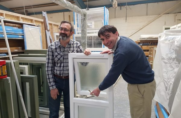 The directors show off a wooden window with lovely ironmongery