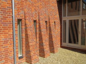 Direct glazed hardwick windows hidden in reveal brickwork red brick
