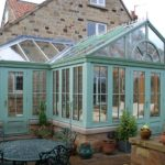 Garden room with farrow and ball painted hardwood conservatory