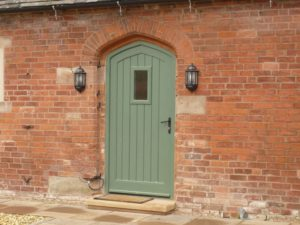 Gothic arched Melbourne door vision panel booth painted brick stone cill barn conversion