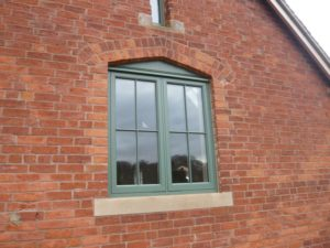 Hardwick casement Booth painted brick barn conversion crucifix astragal double casement radial top scribe