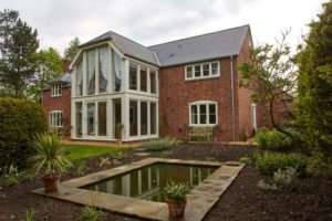 Hardwick casement window white painted red brick elevation horizontal bar new build glazed 2 two storey screen clad steel 2