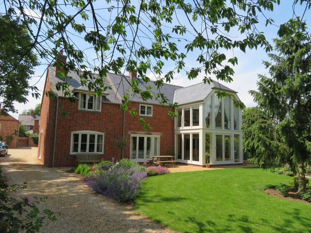 Lovely 2 storey wooden conservatory and flush casement windows all made from sustainable wood