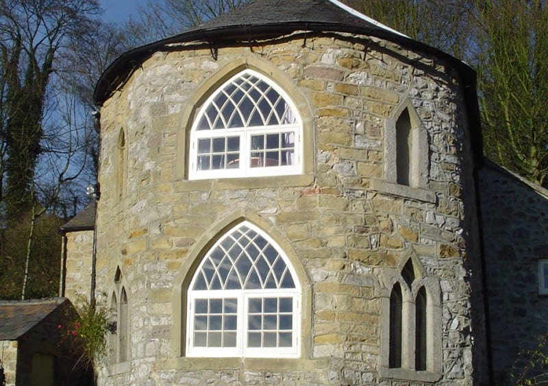 Gothic wooden heritage windows built by Gowercroft fitted to an imposing grade II listed building