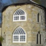gallery gothic style church building with arched wooden heritage windows