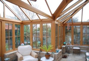 garden room with wooden conservatory and casement windows