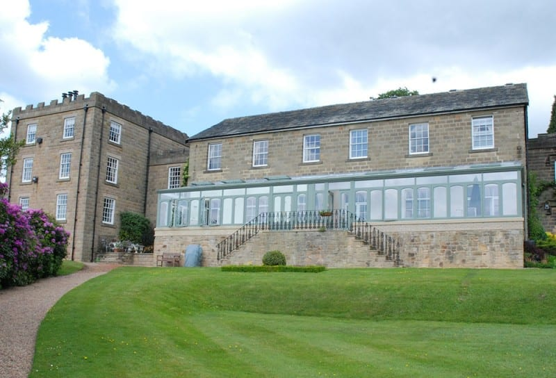 garden of hall with huge length of wooden windows all very stylish