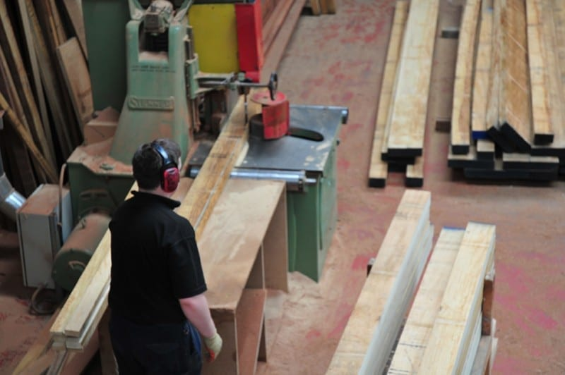 Workshop with raw materials ready for wooden window frame