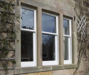 Wooden sliding sash windows at The Common in detail