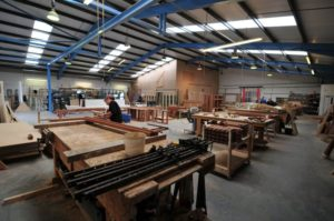 The Gowercroft window manufacture workshop with men hard at work