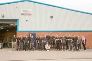 The staff at Gowercroft Joinery in Alfreton line up for a photo outside the wooden window manufacturing plant in alfreton