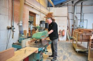Worker building a wooden window to the highest specifications in a workshop in Derbyshire