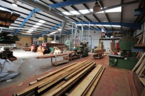 Wooden window manufacture plant in derbyshire with raw materials ready for building windows