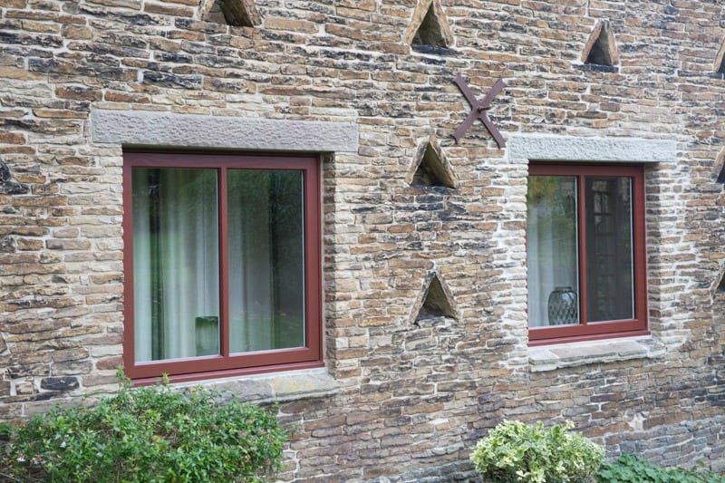 casement windows in stone setting