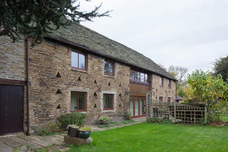 Chesterfield barn conversion showing hardwood casement windows and bifold doors