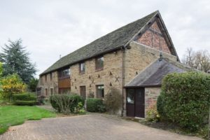 Beautiful barn conversion in chesterfield with sympathetic hardwood casement windows and bifold doors