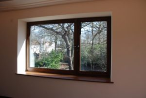 Hardwood Kedleston tilt and turn window dark stained idigbo double casement