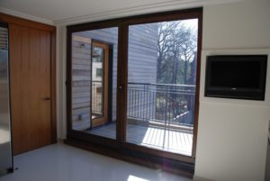 Hardwood tilt and slide door dark stained idigbo 2