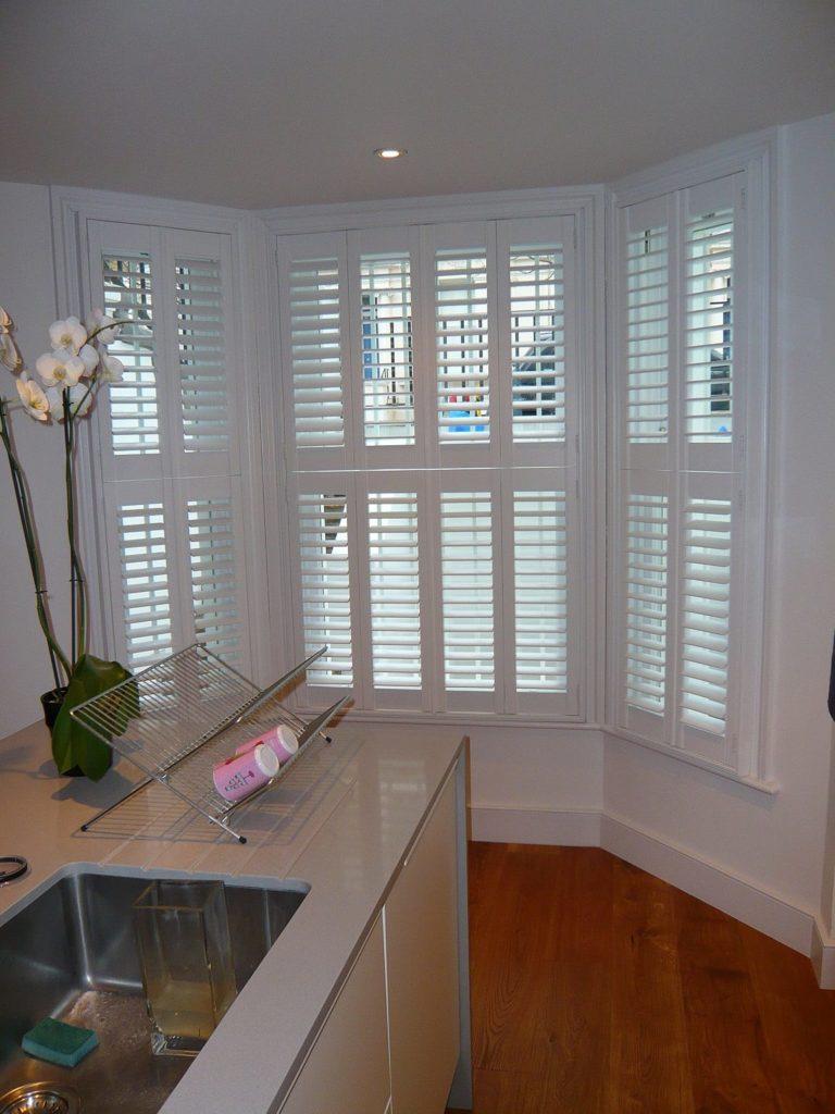 Chatsworth sliding sash bay window internal view white internal shutters blinds