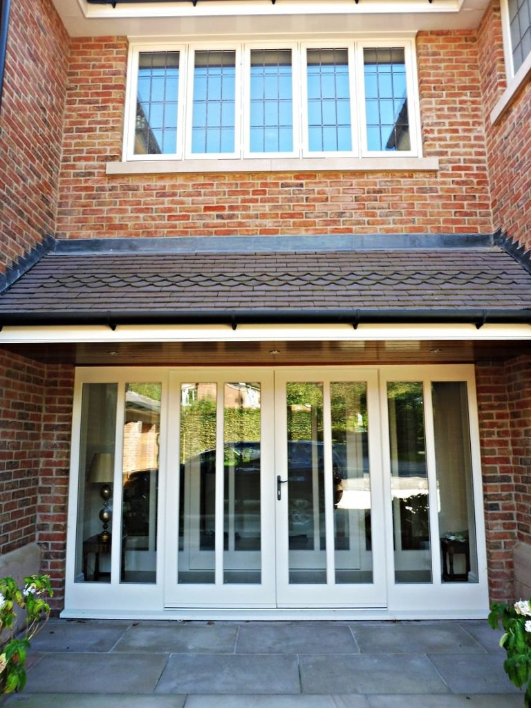 Hardwick casement windows 5 five panel lead painted strutt yellow Melbourne french doors side lights attached top bottom rails brick building