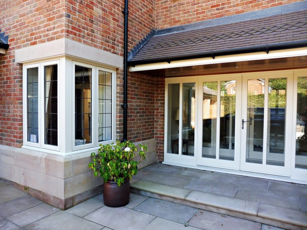 Hardwick casement windows corner bay post square lead painted strutt yellow Melbourne french doors side lights attached top bottom rails brick building