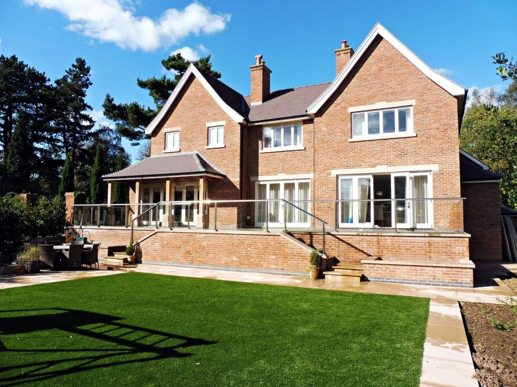 Hardwick casement windows square lead glass elevation painted strutt yellow Tutbury bifold doors reclaimed brick building