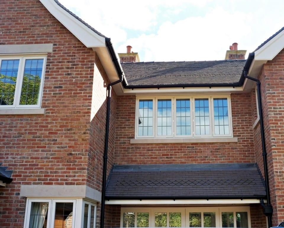 Hardwick casement windows square lead glass painted strutt yellow 5 five panel casement brick building