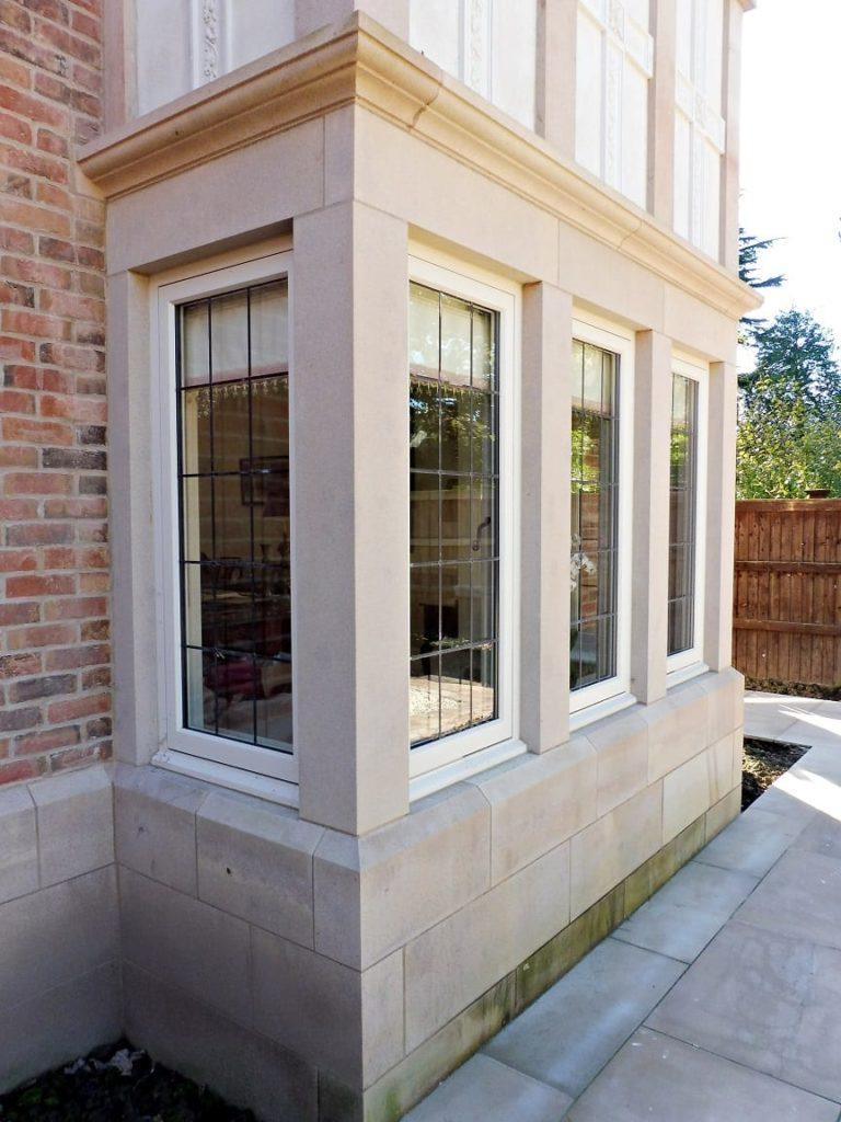 Hardwick casement akoya windows stone mullions square lead glass painted strutt yellow square bay 2 two storey