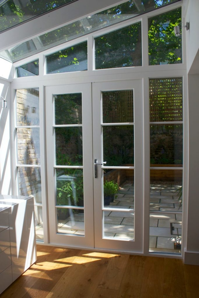 Internal view lean to conservatory angled screen french doors white