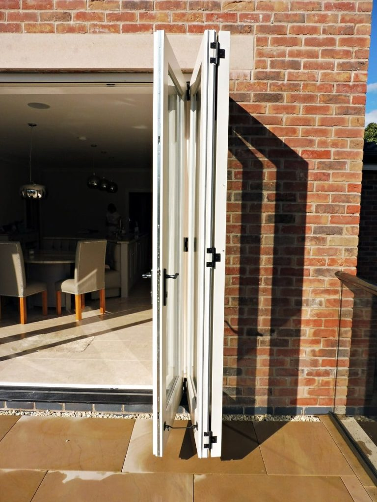 Tutbury bifold door 3 three panel painted strutt yellow clear glass fully open folded back