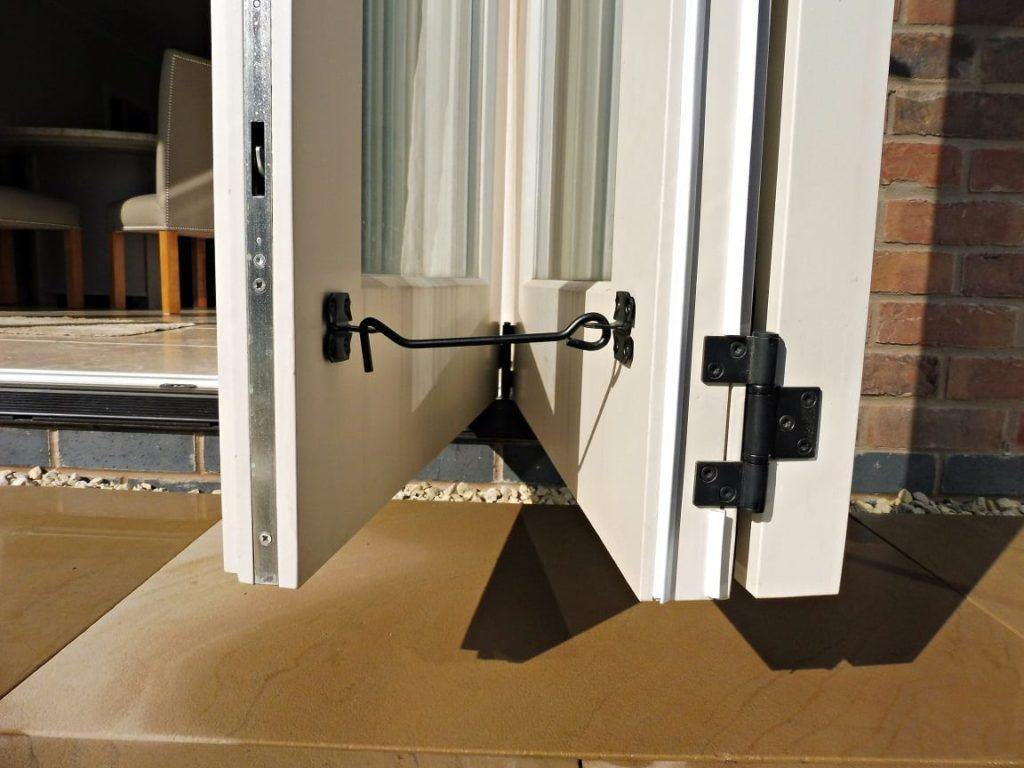 Tutbury bifold door 3 three panel painted strutt yellow clear glass fully open folded back cabin hook restraint