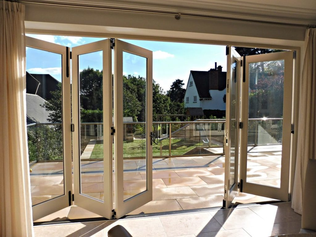 Tutbury bifold door 5 five panel painted strutt yellow clear glass partially open internal view