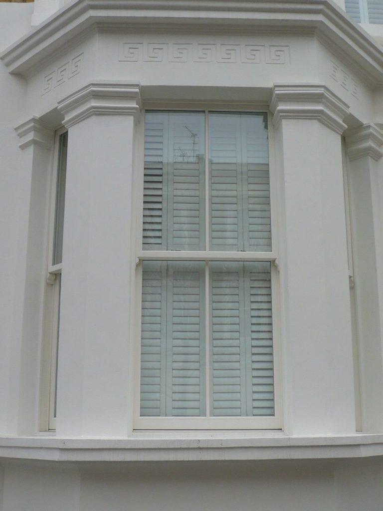 Victorian Chatsworth sliding sash window spiral painted white stone bay