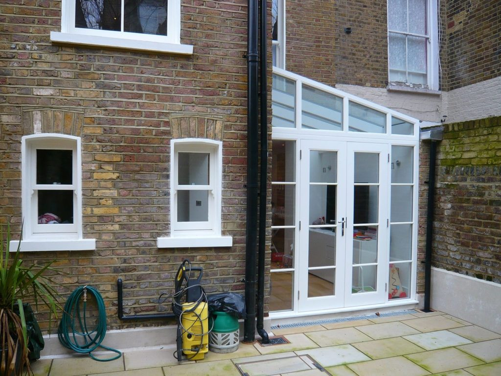 White Chatsworth sliding sash windows lean to conservatory townhouse 2