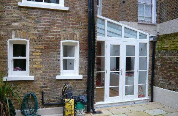 White Chatsworth sliding sash windows lean to conservatory townhouse 2