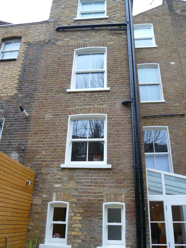 White Chatsworth sliding sash windows lean to conservatory townhouse