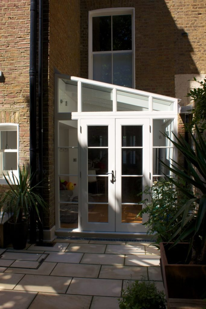 White painted conservatory garden room french doors angled screen