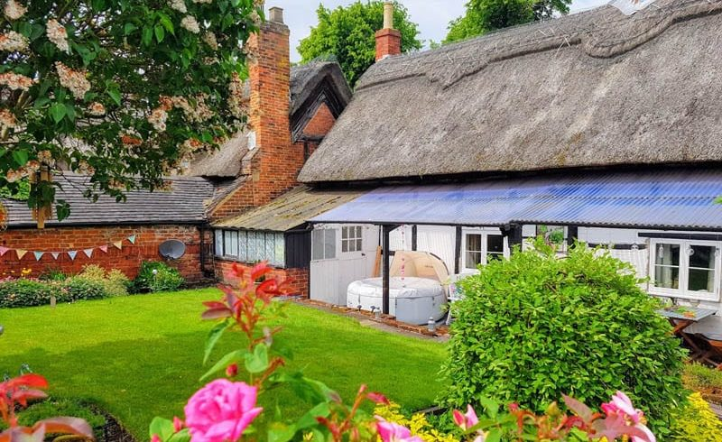 Richmond casement windows in thatched cottage teachers lodgings part of Repton School in Derby